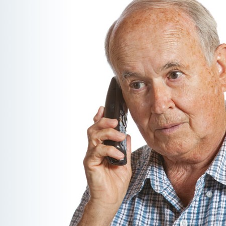 Older man on cordless phone