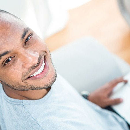 Cheerful man with laptop
