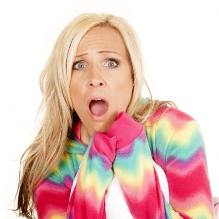 Woman in pyjamas with shocked expression
