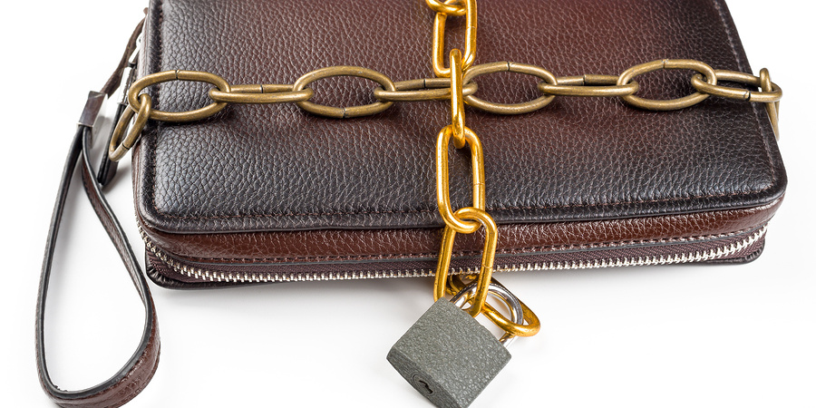 Clutch, chained with a padlock on a white background
