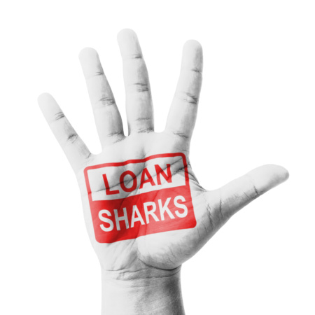 Open hand raised Loan Sharks sign painted