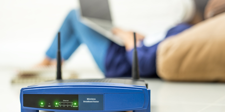 Router with person in background looking at laptop