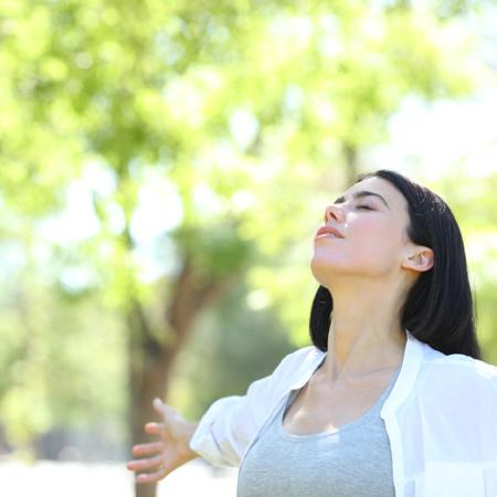 Woman breathing in park