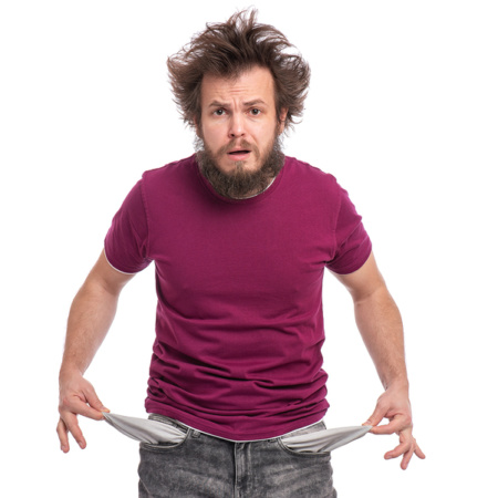 Shocked man with empty pockets