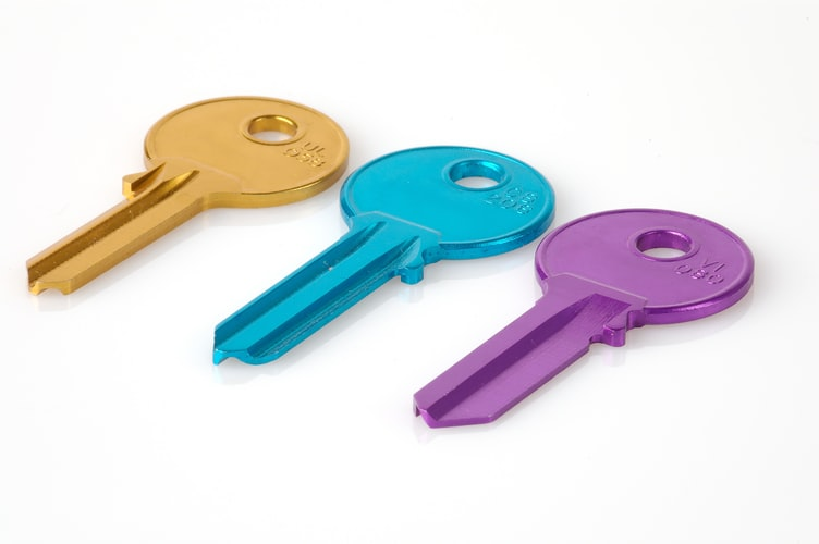 Three different colour house keys