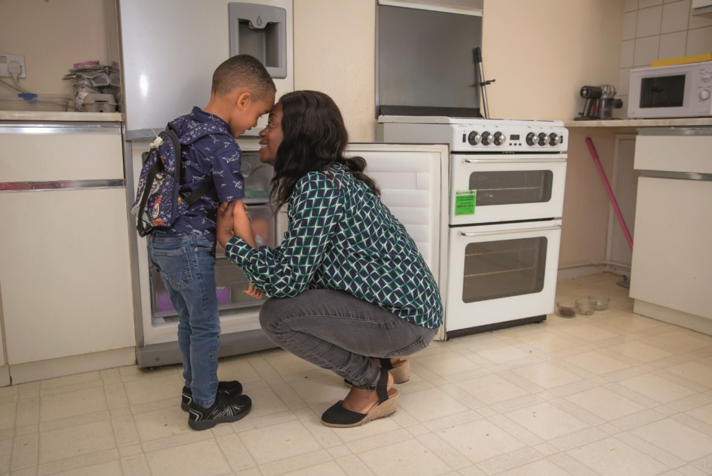 Mum and Son smiling together in kitchen