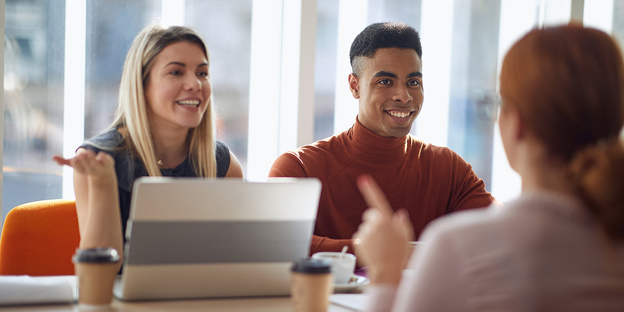 Young woman meeting two employers at interview