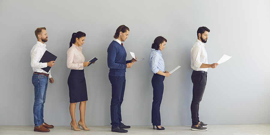 Job applicants stand in line for interview