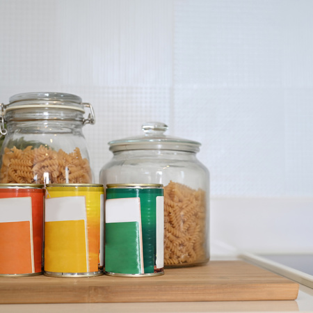 Jars of pasta and tins on a shelf