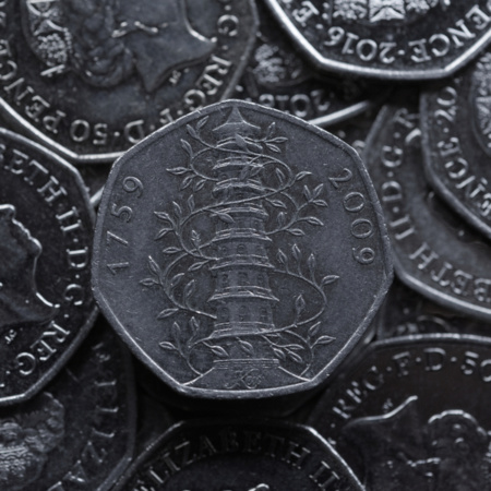 A stack of 50 pence pieces